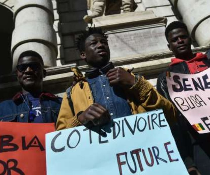 Migrants from Gambia and Senegal take part in a protest against global warming in central Turin on March 15, 2019. (Photo by Marco BERTORELLO / AFP)