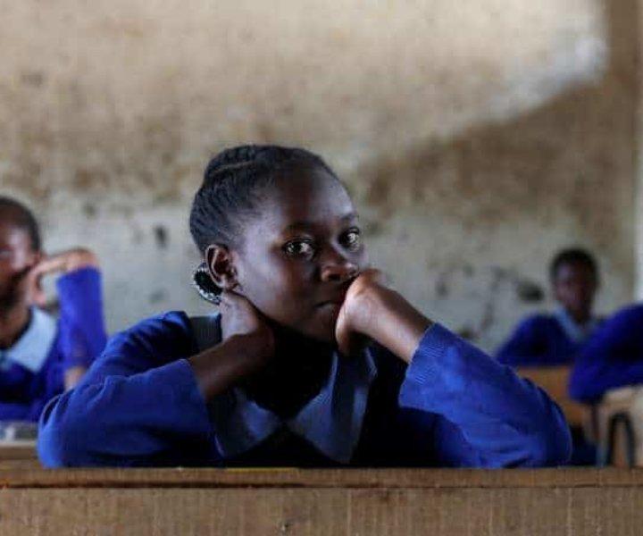 A pupil sits inside a classroom ahead of the primary school final national examinations at Kiboro Primary school along Juja road in Nairobi, Kenya October 31, 2017. REUTERS/Thomas Mukoya - RC1294BA3D70